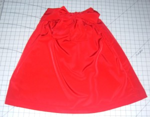 Red skirt with a sash